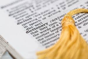 close up of a page from the dictionary with a bookmark