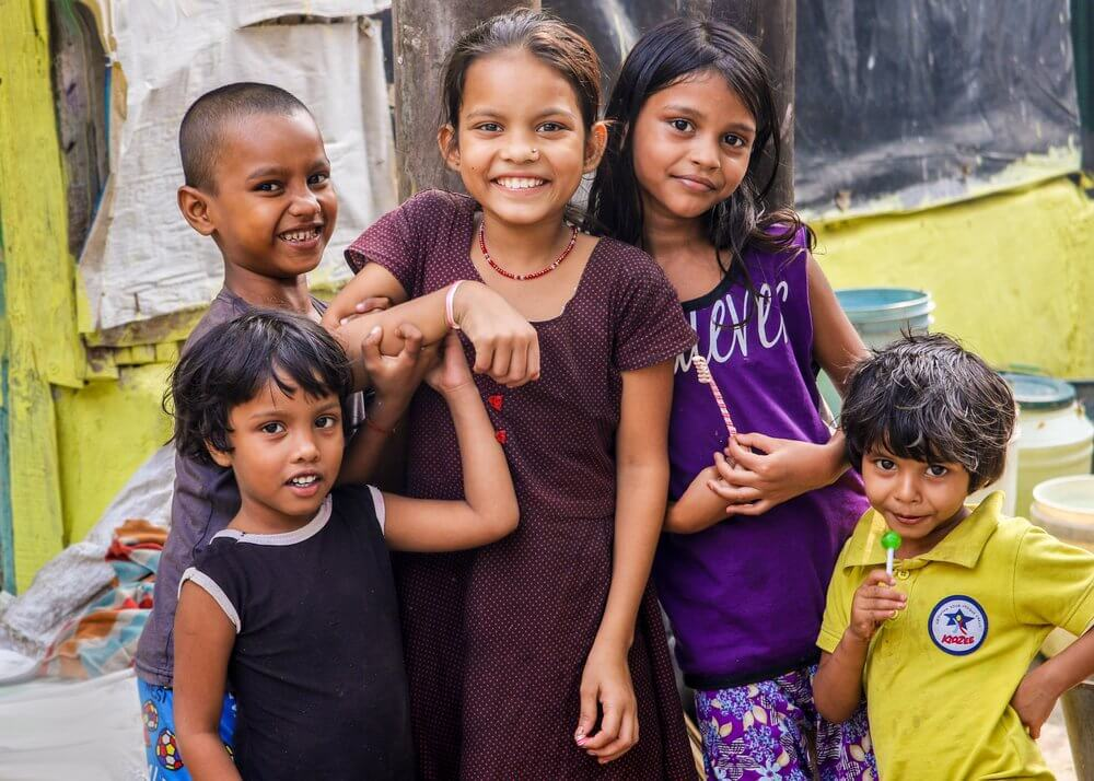 five Indian children smiling at the camera