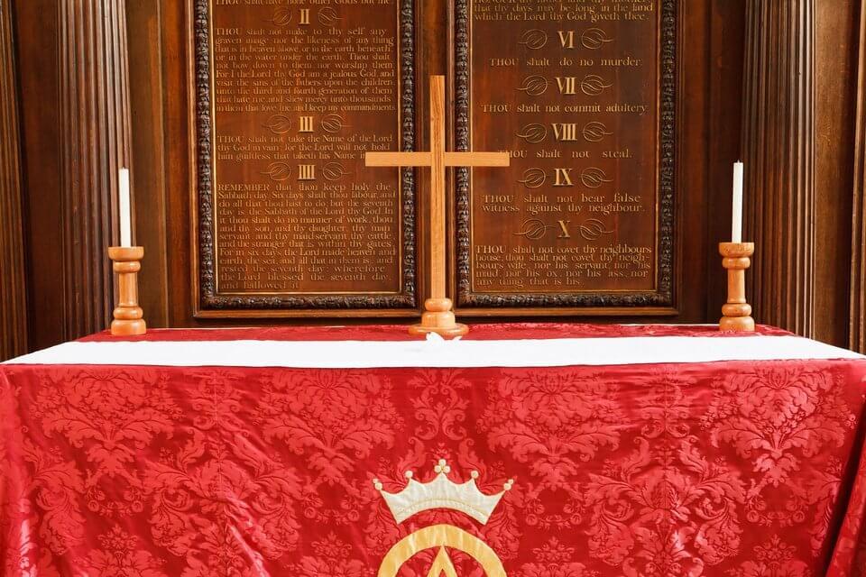 Red altar cloth on an altar