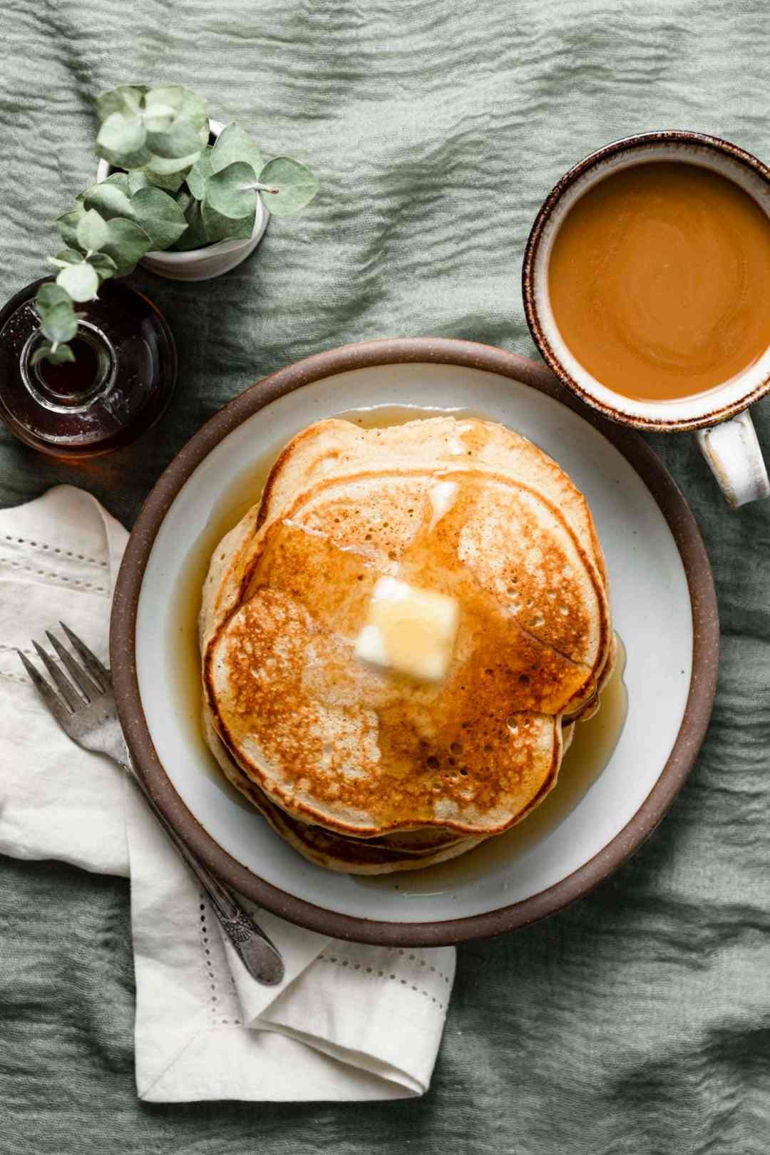 Breakfast pancakes made with eggnog, cinnamon, and nutmeg