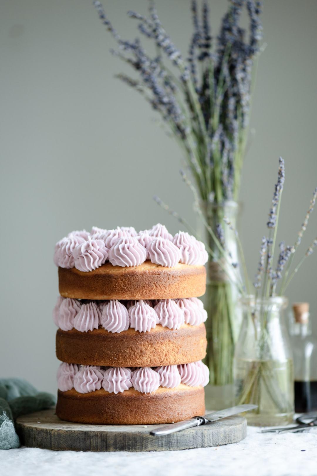 Layered vanilla cake with purple frosting.