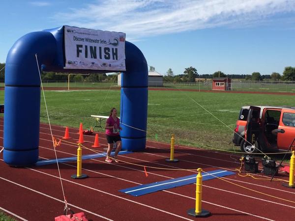 Crossing the half marathon finish line