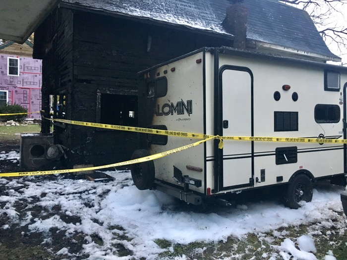 Back view of fire-damaged camper