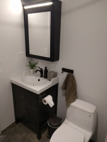 Finished bathroom sink and mirror