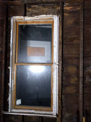 Old window and rotten sheathing