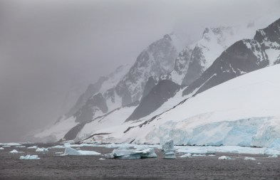 Dramatic mountains rising from the Antarctic Sea.