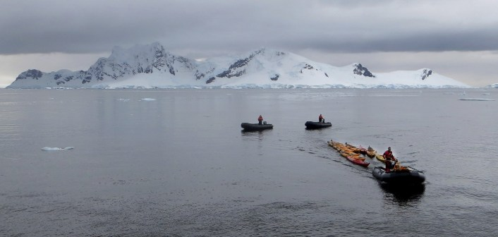 Our One Ocean guides collect the kayaks and pull them back to the ship.