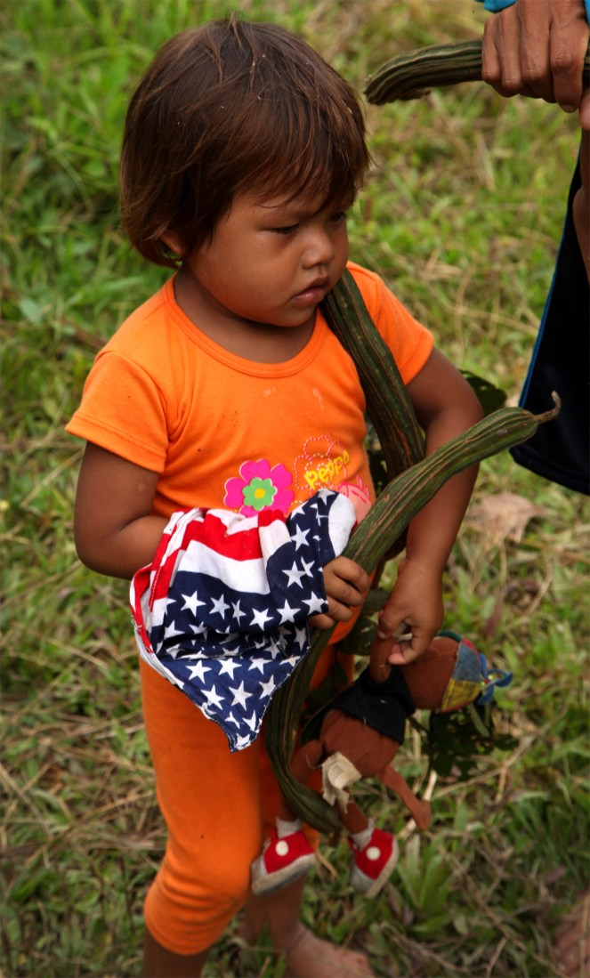 This young Huaorani girl brought out the stars and stripes in honor of our arrival.