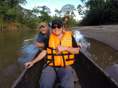 Settling in for the ride in our wooden dugout canoes, which would take us down river to the lodge.