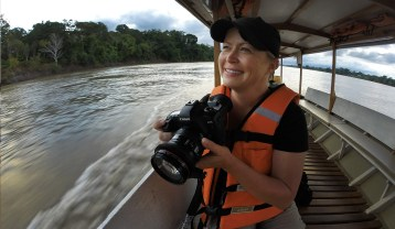 Spotting wildlife along the Madre de Dios River, Peru.