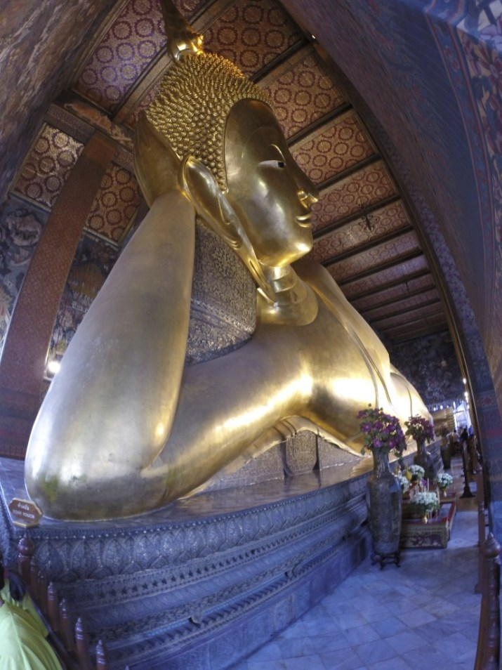 "Bangkok's famous ""reclining Buddha."" Thing's HUGE."