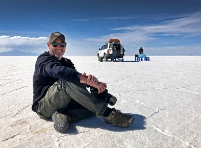 Taking a break from filming on the salar, while our guides set up for lunch in the background.