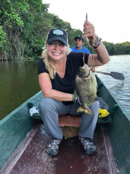 It's true! Nik caught the largest yellow-bellied piranha ever caught on Chalalan Lake!! The guides were going out of their minds at the sight of this thing!