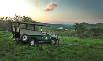 After a full day's game drive, we stop on a bluff high above the reserve...