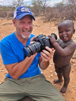 Dusty getting photography tips from one of the Himba kids. Precious!