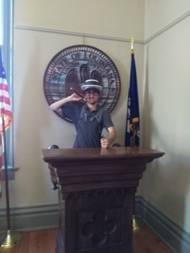 Impersonating Huey Long.