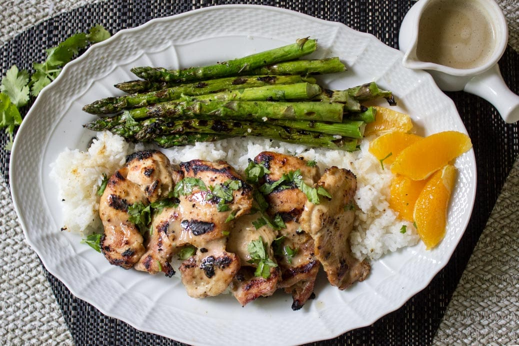 Thai-inspired marinated grilled chicken. Super flavourful with coconut milk, curry paste, maple syrup, garlic and soy.