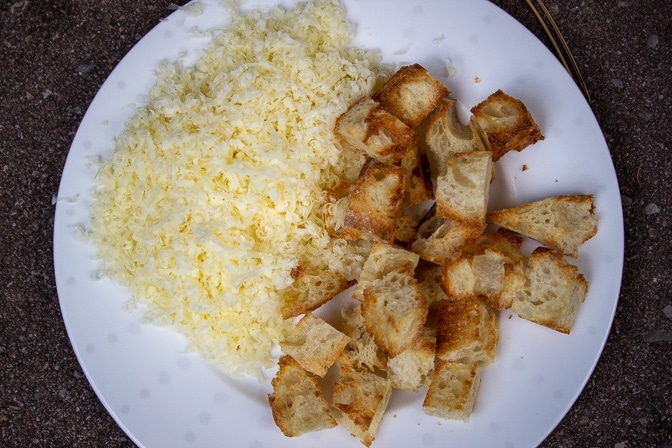 toasted bread cubes and grated gruyere cheese