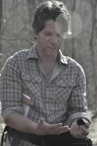 David Rasmussen foraging for wild edibles