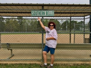 "Photo: Debra in front of a ""southern belle"" sign at Nashville City Park"