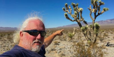 Photo: Robert in the Nevada desert by a Joshua Tree