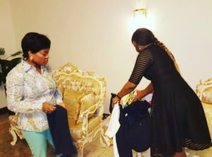 The first lady of Rivers State looking on as twon-by-jane creative designer as she lay out some of her pieces