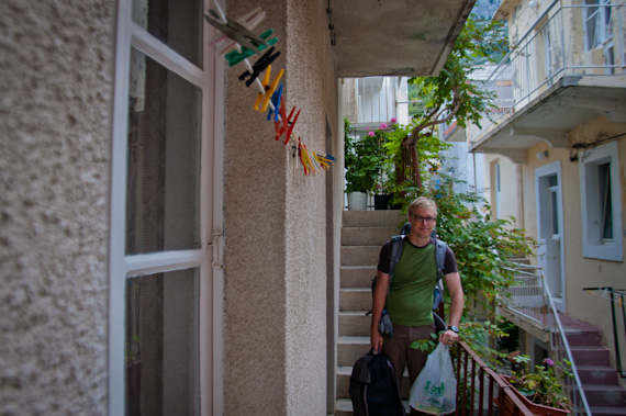 Ted and his backpack among clothespins and green balcony plantings outside our Croatian apartment
