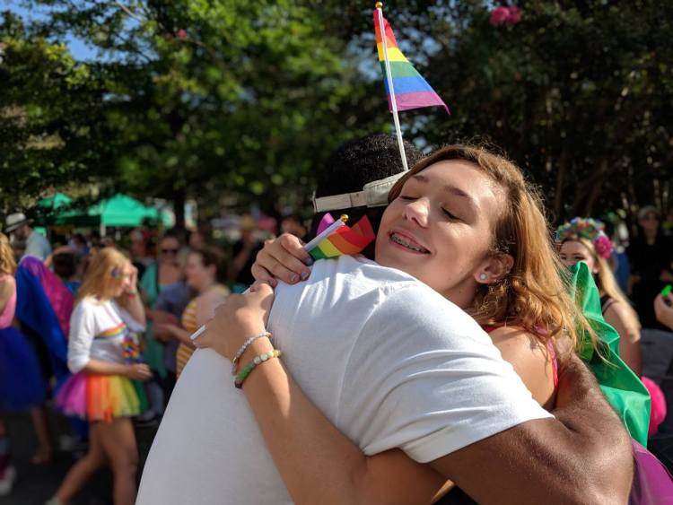 Charles Monteith shares a hug during the 2018 Charleston Pride Parade.