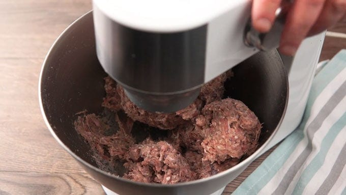 Shot of stand mixer paddling meat