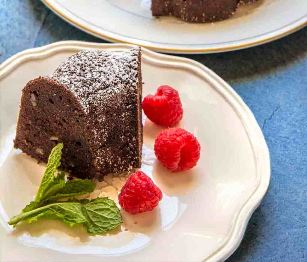 This will be your best keto dessert recipe ever. Pour and Bake keto dark chocolate walnut cake. High-fat, low carb, gluten-free, vegetarian cake. Deep chocolate flavor. Tastes just like the real thing!