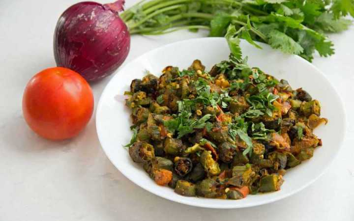 This recipe for Indian Bhindi Masala, or okra with onions and tomatoes, will be the easiest and most authentic recipe you will ever make. Make restaurant-style Bhindi Masala at home with very little effort.