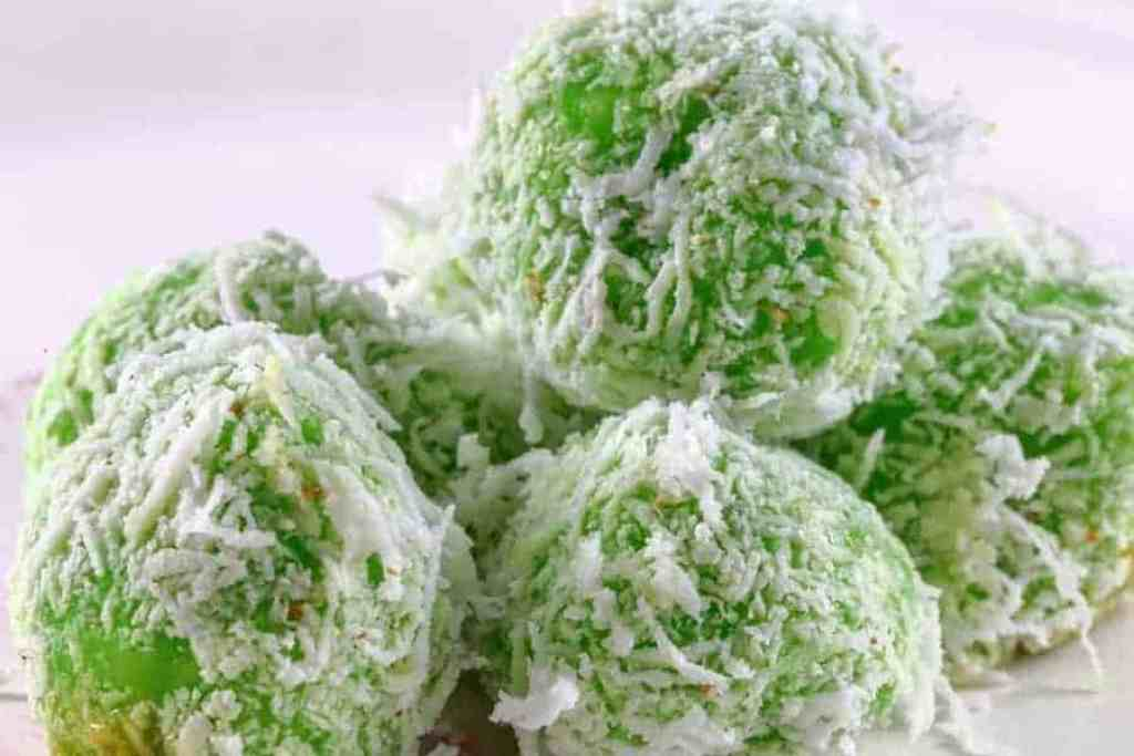 Selection of green ondeh ondeh balls piled on top of each other. Bite into the perfect mix of pandan and coconut,Nyonya Ondeh Ondeh,and serve a dessert the whol