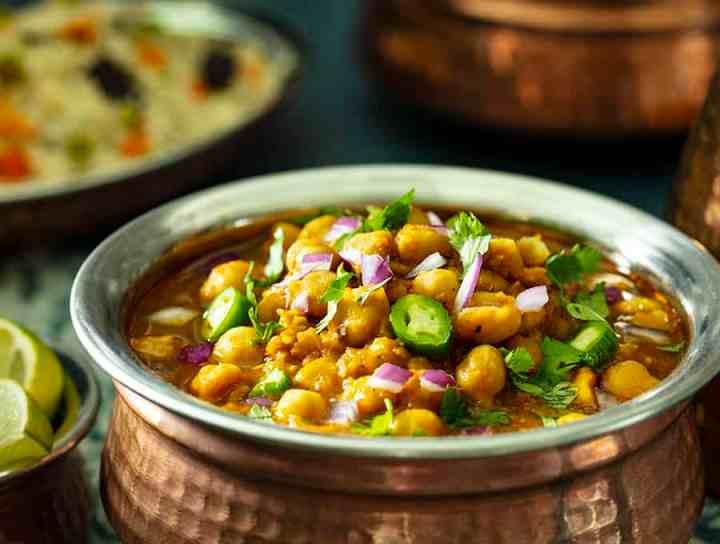 chana masala in brass serving bowl