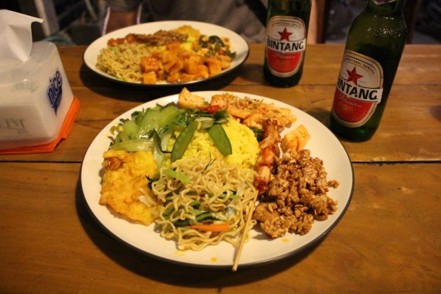 Plate full of Indonesian food and Bintangs
