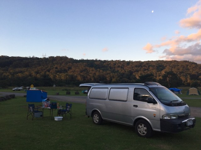 Camper van with table and chairs parked in kangaroo valley