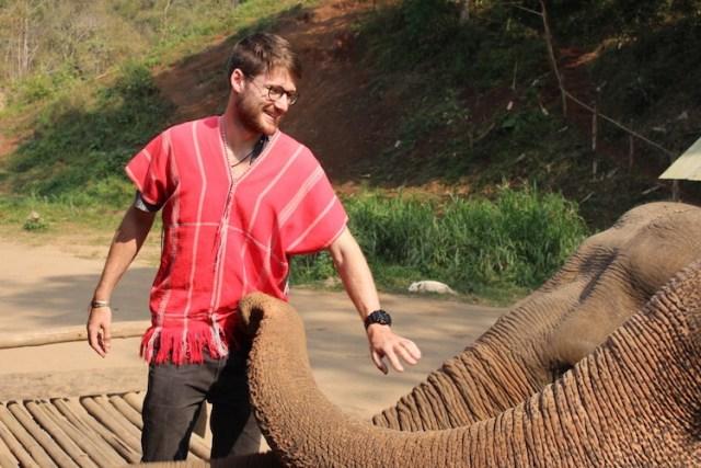 Matt-bonding-with-elephants-Ethical-elephant-sanctuary-Chiang-Mai-Two-Souls-One-Path