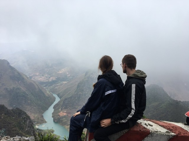 Matt and Lorna sitting overlooking views during the Ha Giang Loop