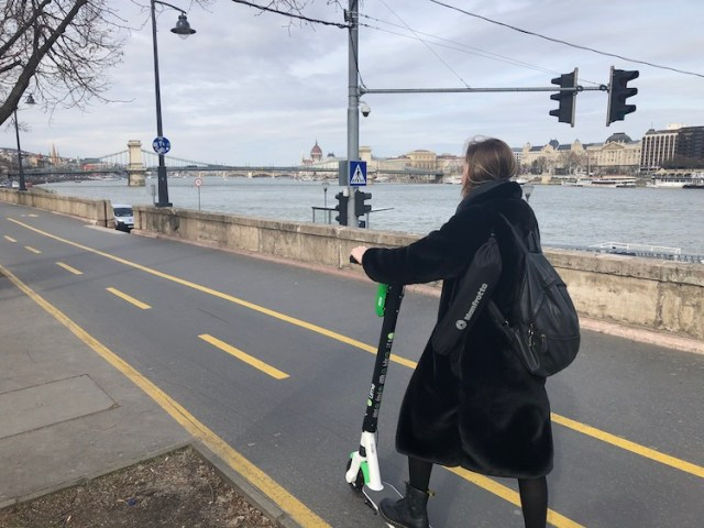 Lorna on a Lime Scooter in the bike lane