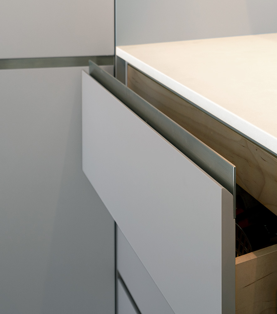 Stainless steel drawer pull accents