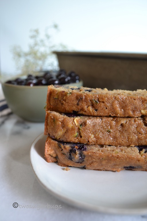 Wholesome and healthier zucchini blueberry bread. You'll feel good feeding this one to your family! #twosugarbugs #zucchinibread #healthierzucchinibread #breakfastisserved