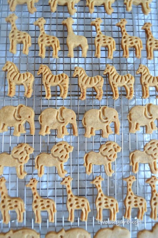 Homemade Graham Animal Crackers.  Kid friendly and mom approved!  Perfect on their own or add a twist with glaze and sprinkles.  #twosugarbugs #homemadegrahamcrackers #animalcrackers #cutefood #lunchboxtreats