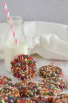 Milk and a pile of chocolate confetti cookies