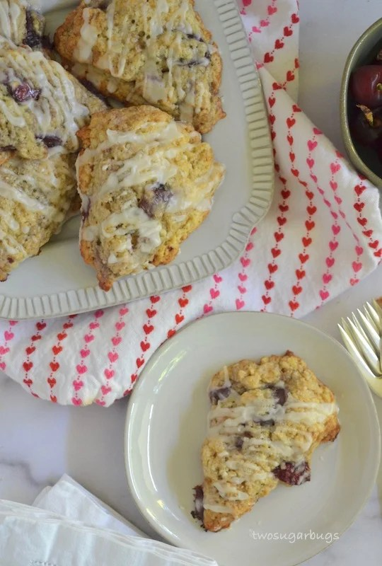 Cherry almond scones piled on a plate.