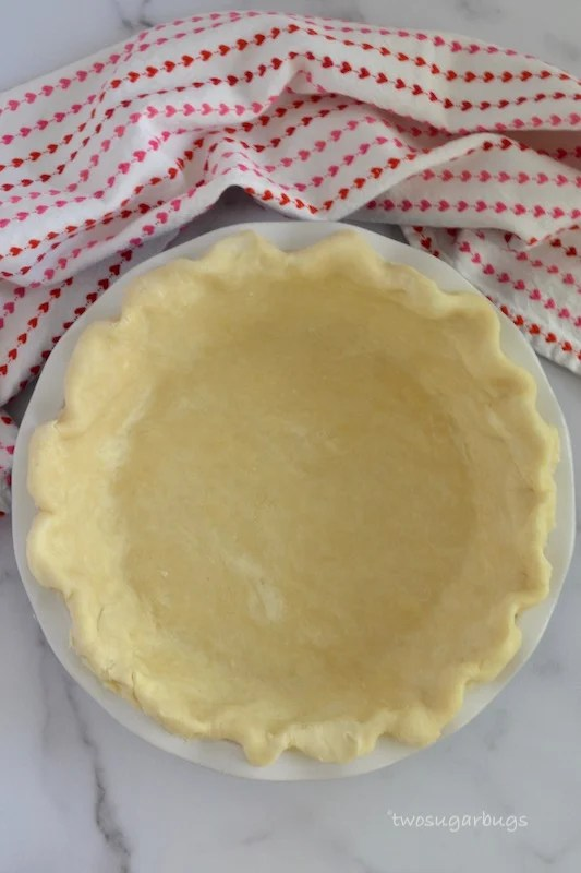 Pie dough fitted into a pie plate