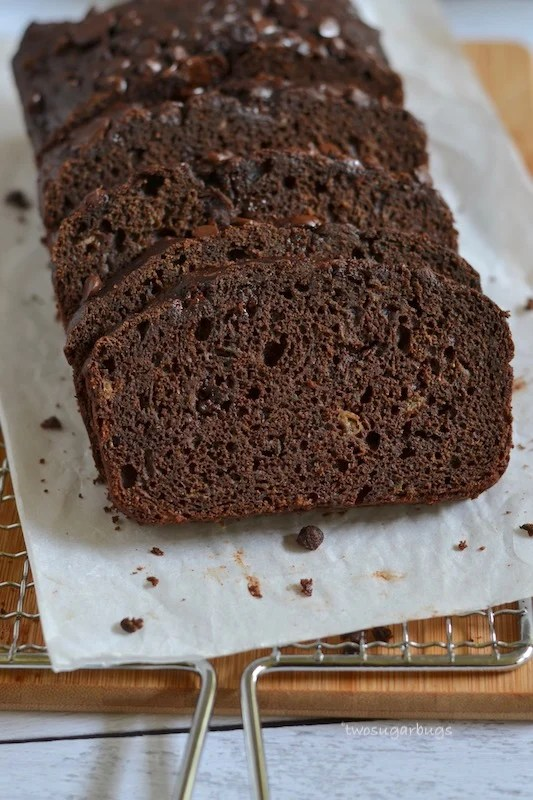 Slices of chocolate zucchini bread on parchment paper