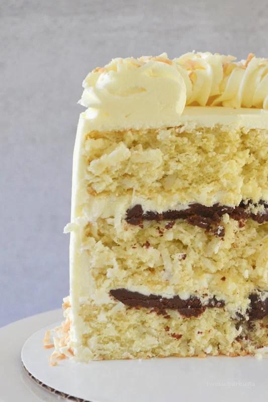 Inside slice of perfect coconut cake with dark chocolate ganache