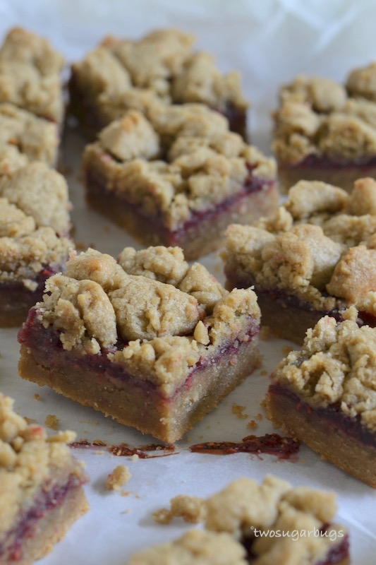Sunbutter and jelly bars, cut in squares on parchment paper