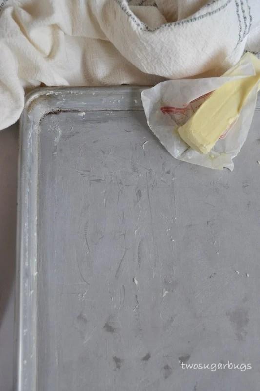 Buttered baking sheet.