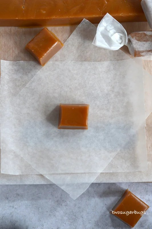 caramel centered on wax paper rectangle