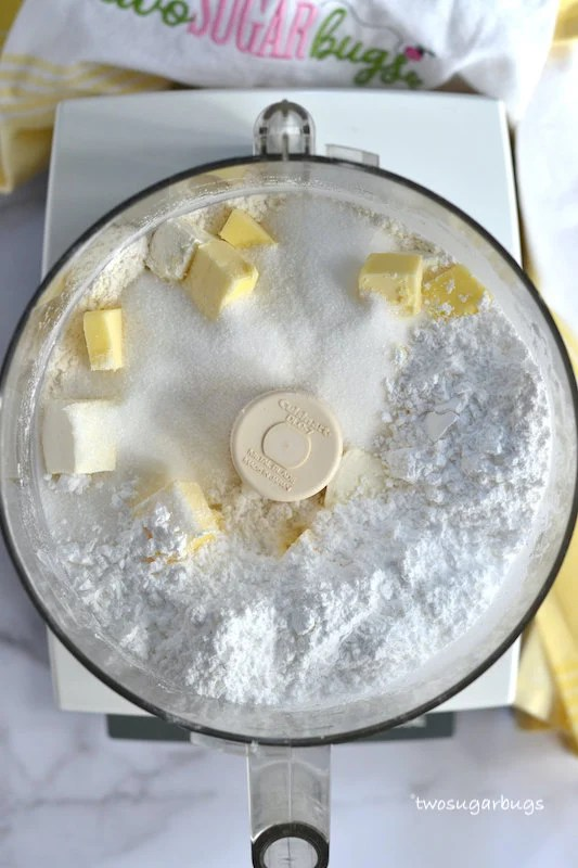 flour, butter, sugars and cream cheese in a food processor